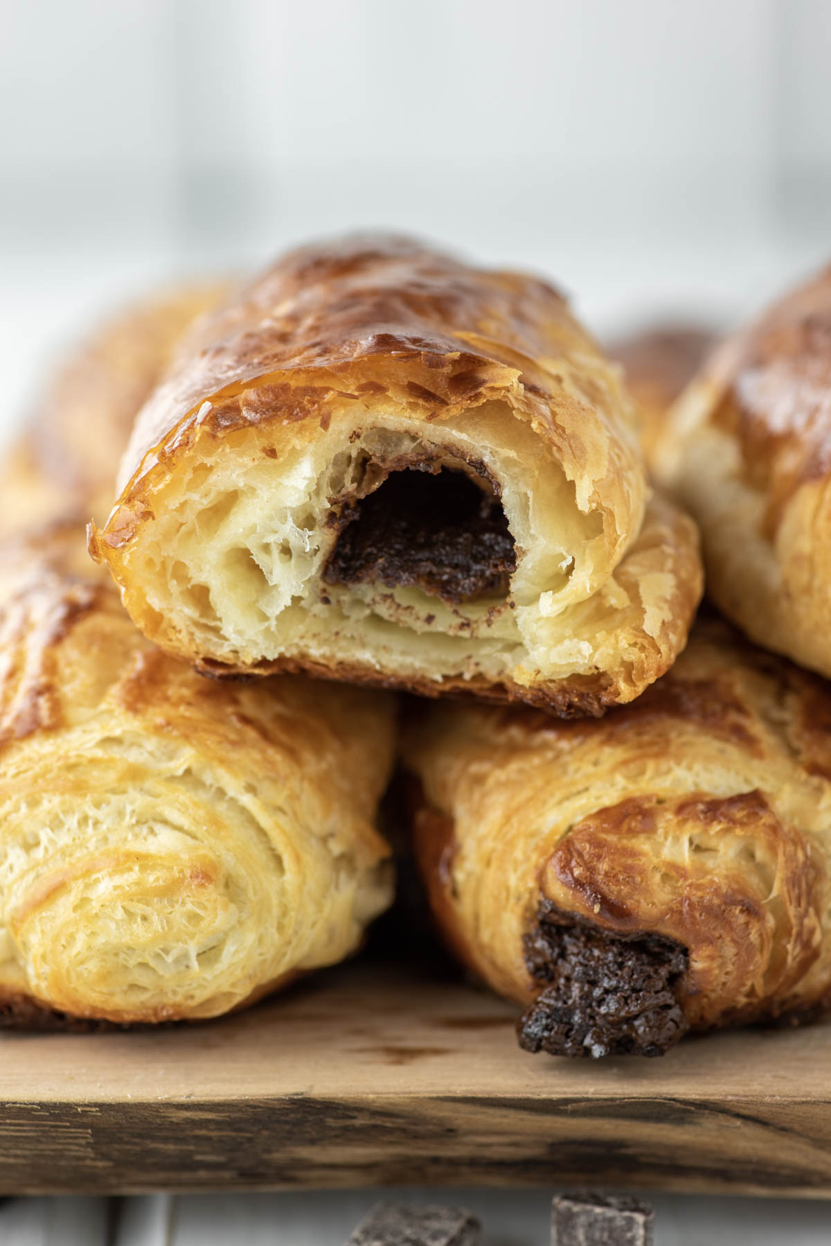 eaten chocolate croissant stacked on other croissants