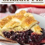 slice of homemade cherry pie on white plate with fork