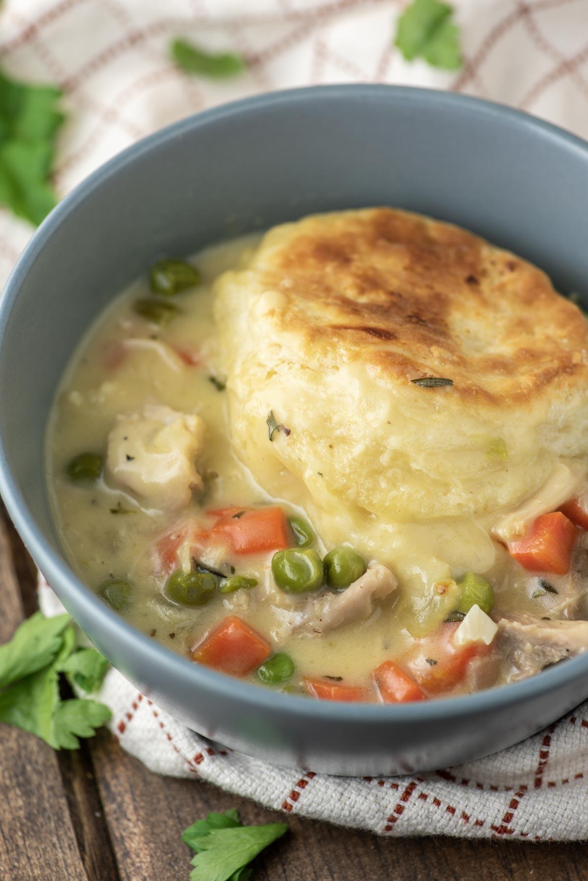 chicken biscuit pot pie in gray bowl