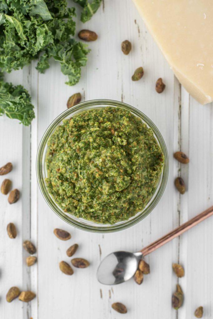 overhead shot of kale pesto in glass bowl