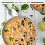 overhead shot of chicken enchilada soup in grey bowl