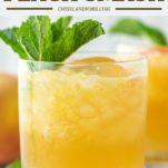 glass of bourbon peach smash with fresh mint