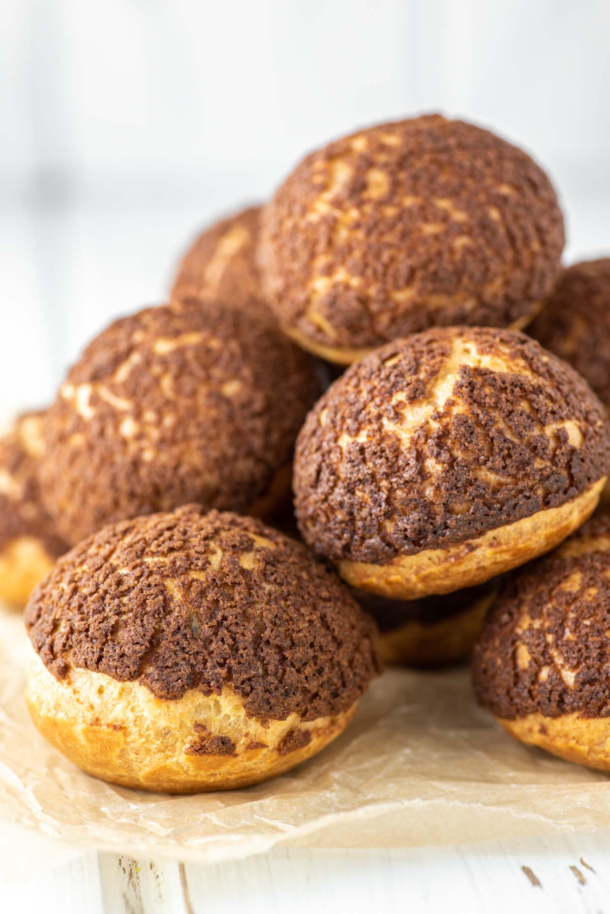 chocolate cream puffs stacked on top of each other