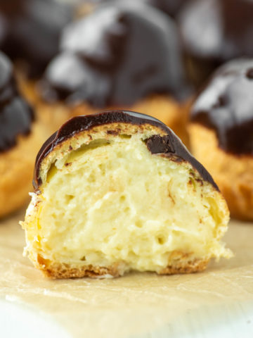 cream puff sliced in half showing pastry cream