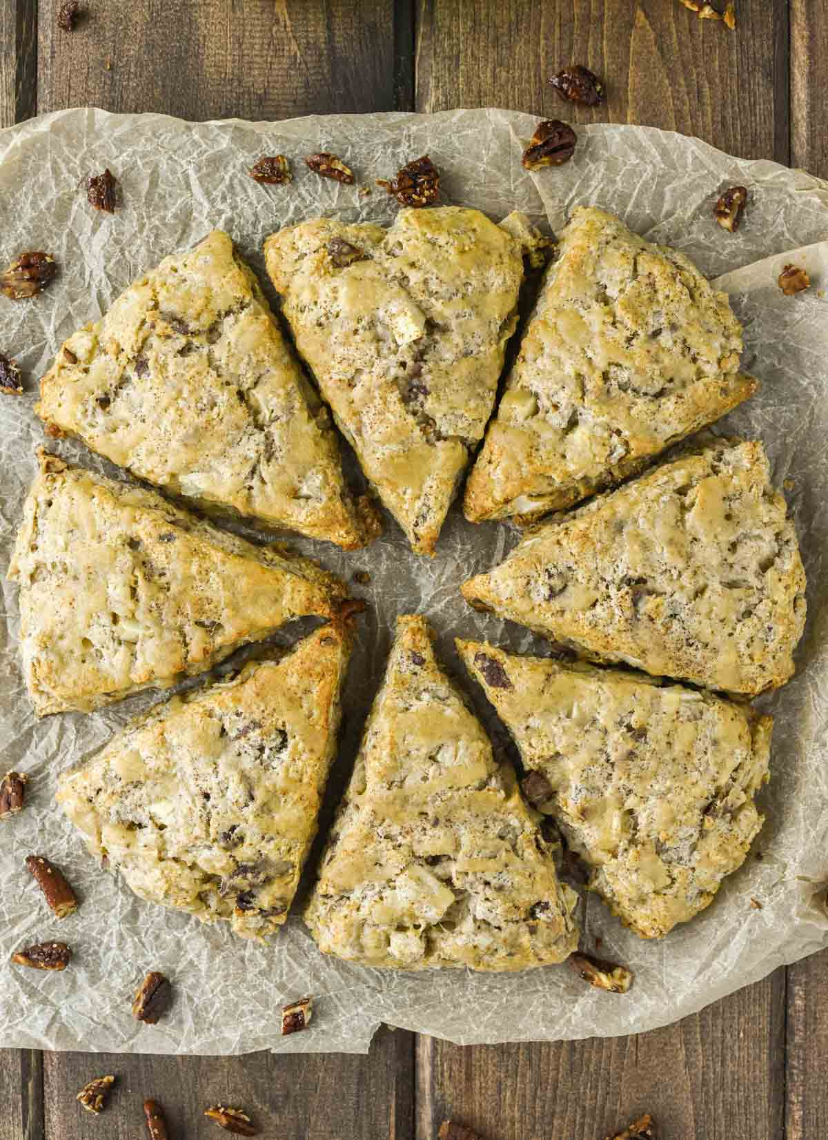 overhead shot of 8 apple scones on parchment paper