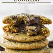 stacked brown butter chocolate chip cookies on parchment paper
