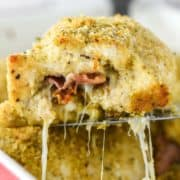 chicken rollatini being lifted out of baking dish on spatula