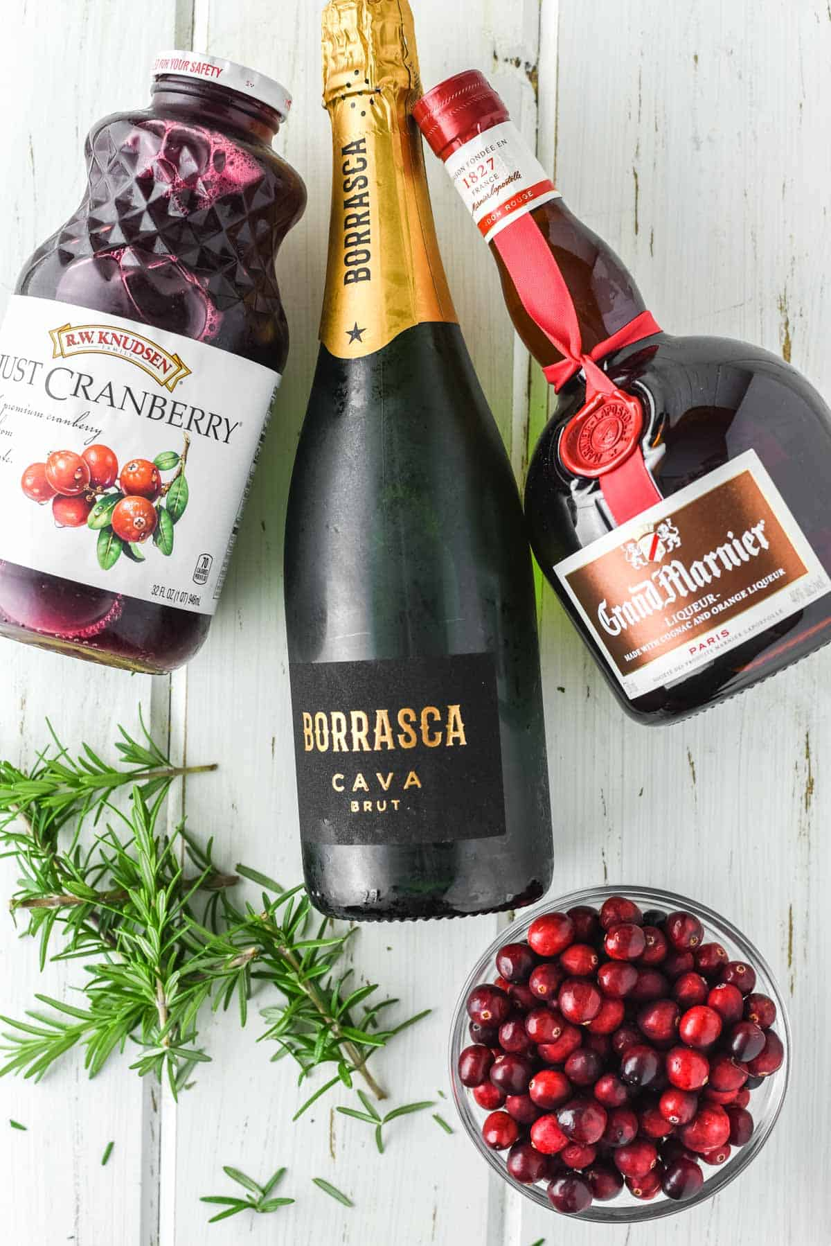 overhead shot of the ingredients for a cranberry mimosa