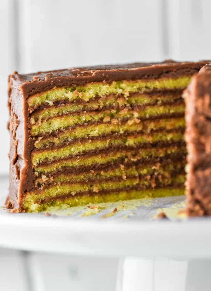 Smith Island cake sliced on white cake stand