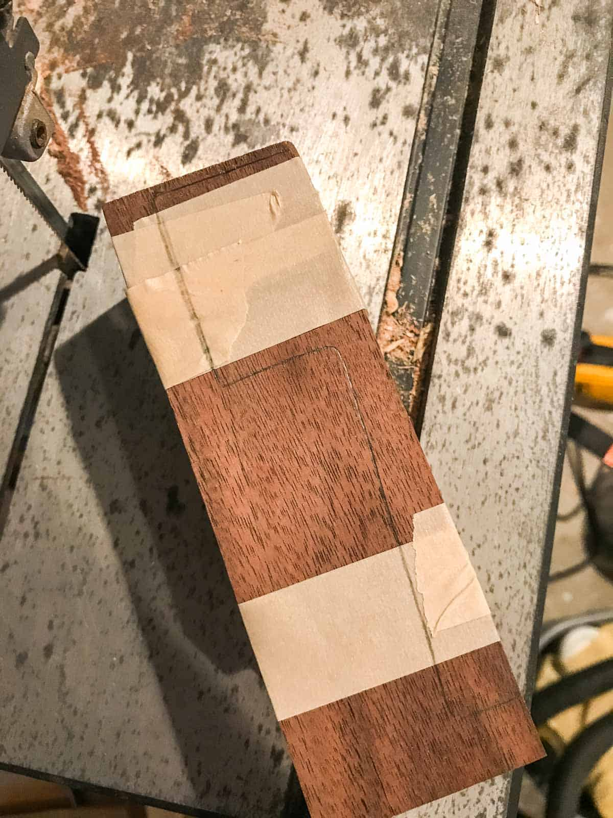 sides of wood taped together on band saw
