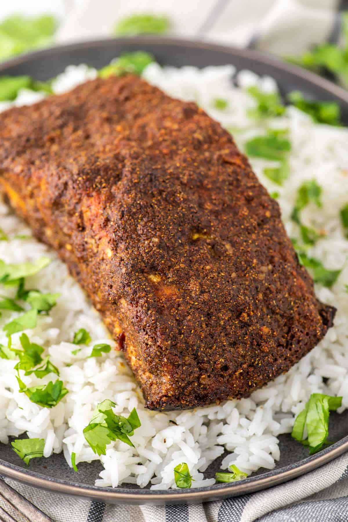 tandoori salmon on grey plate of white rice