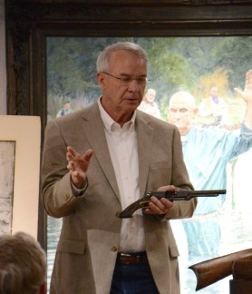 Firearms collector shares the anecdote on how the Walker revolver he is holding came into his possession at the Bosque Museum Sunday, March 8.