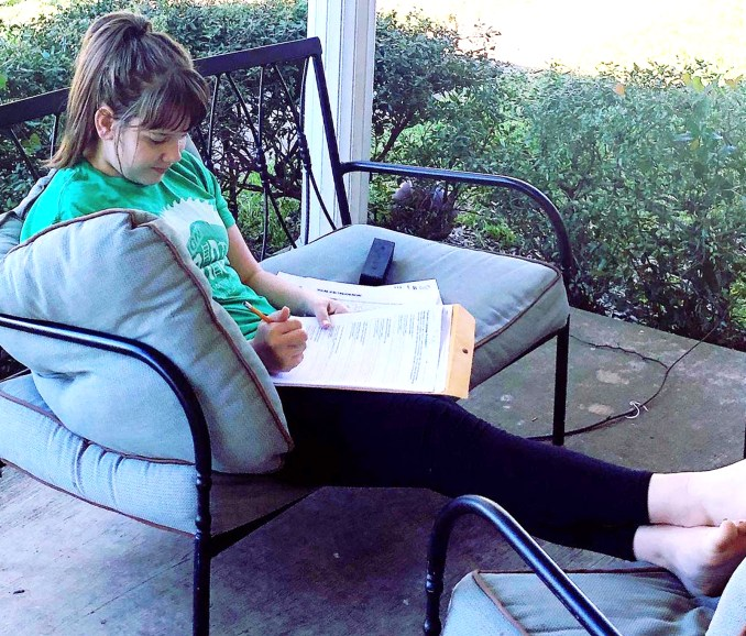Meridian ISD seventh grader Glory Gilbert finds a peaceful spot to do her distance learning school work. Photo by LEIGH GILBERT of Loveleigh Photography