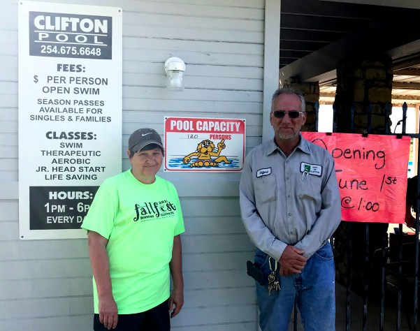 Clifton City Administrator Pam Harvey and Public Works employee Clifford Crosby make last minute preparations Sunday – like stocking the concession stand and checking the water quality.