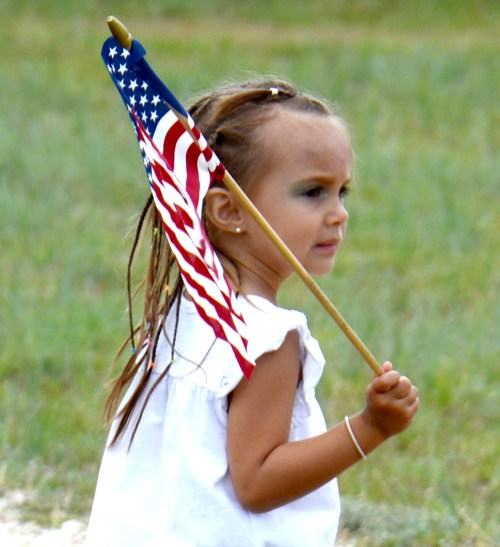 Gracey Dejesus at at Iredell's Mitchell Cemetery May 23 searching for serviceman's graves on which to place a commemorative flag.