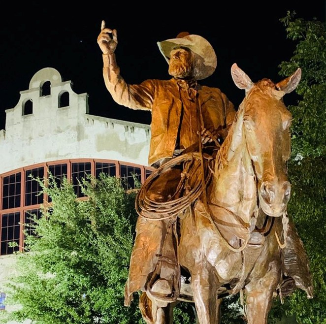 Bruce Greene's sculpture of his friend Red Steagall at the Forth Worth Stockyards.