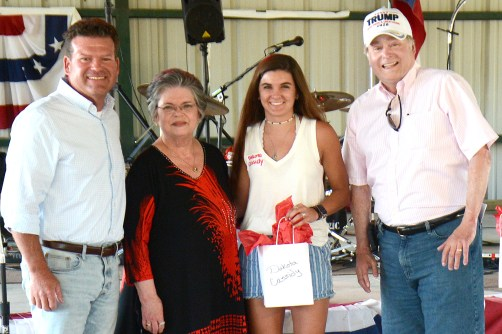 Texas Representative DeWayne Burns, Sue Fielden and Texas Senator Brian Birdwell present Dakota Cassidy with a $1,000 academic scholarship.