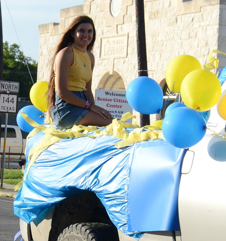 Meridian High School Senior Dakota Cassidy participates in a celebratory convoy down Main Street June 4.