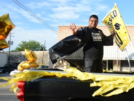 Meridian High School Senior Rey Garza participates in a celebratory convoy down Main Street June 4.