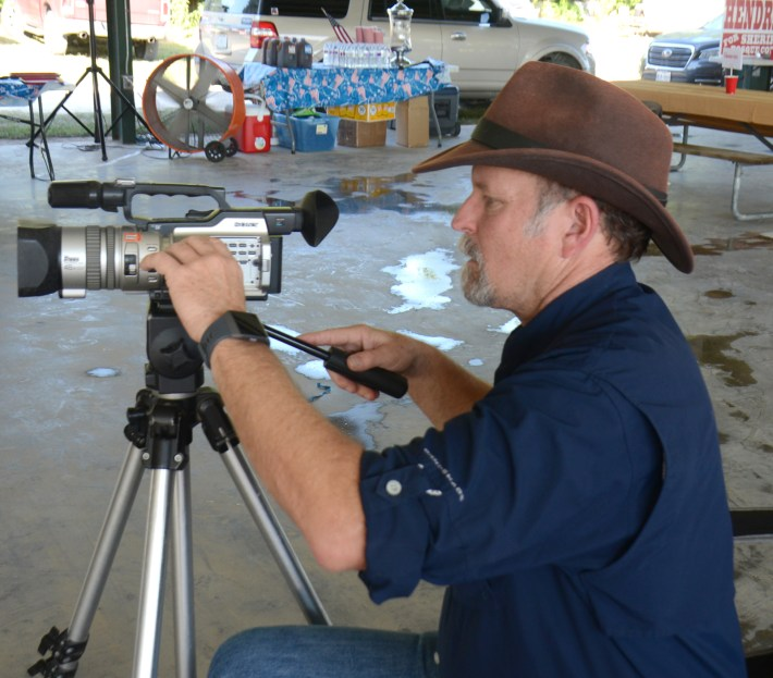 ChisholmCountry.com owner Brett Voss sets up for video recording of the Bosque County Sheriff's race candidate speeches at the Bosque County Republican Club Party in the Park event June 16.