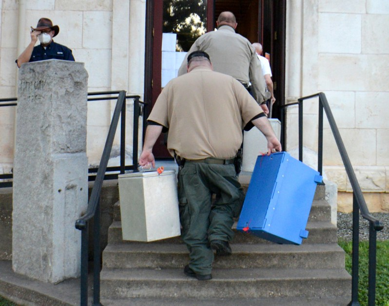 Bosque County Courthouse bailiffs carry in ballot boxes during the Runoff Election July 14 between Republican candidates for Bosque County Sheriff Clint Pullin and Trace Hendricks.