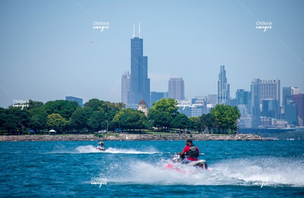 Woodlan Lakefront Jet ski Near The Beach With Downtown Chicago In The Background