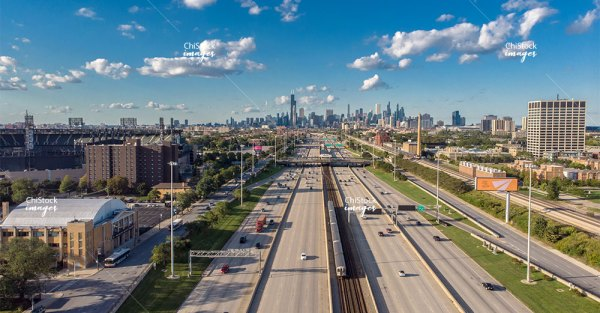 Aerial drone view above I-90 Expressway in Armour Square with Chicago Skyline