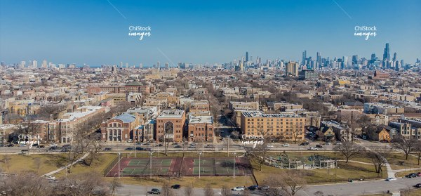Aerial View Above Humboldt Park with the Chicago Skyline