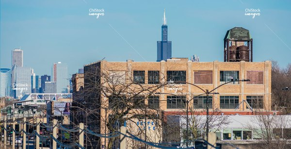 Industrial Warehouse with Sears Tower in the Background in Austin Chicago