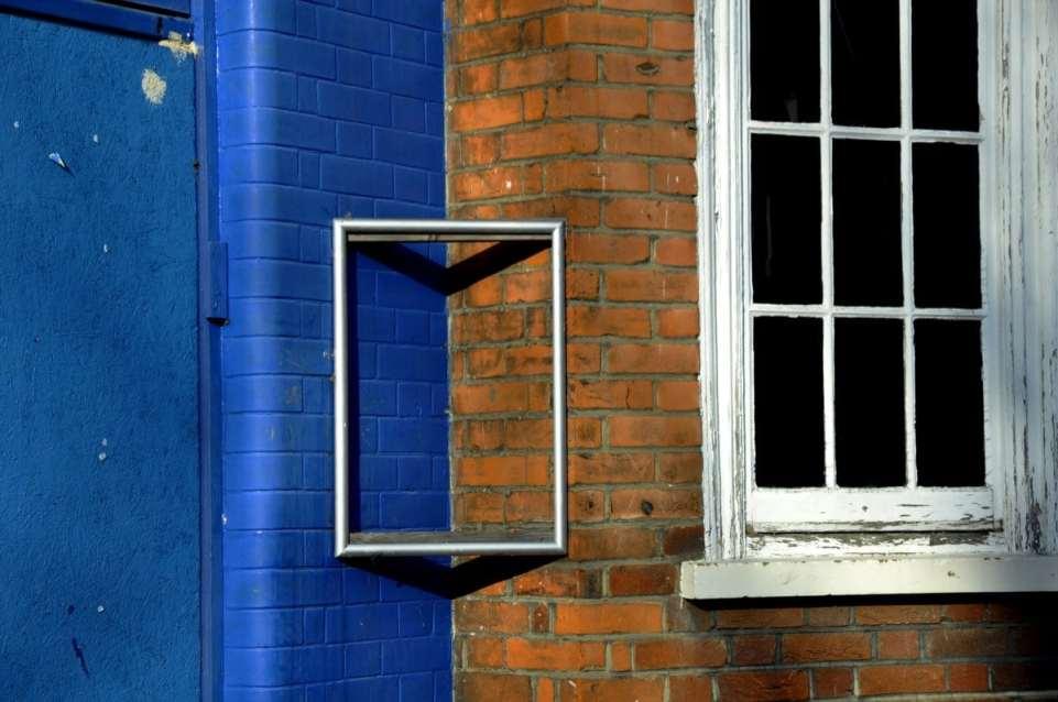 Chiswick Calendar Photographers Marianne Mahaffey Blue paint and Brickwork framed