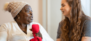 Elderly woman speaking to young girl