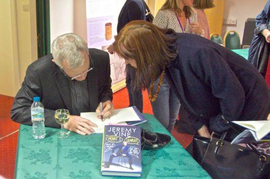 Broadcsater Jeremy Vine signing books