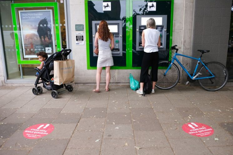 15 June shops open - queuing for the bank_web