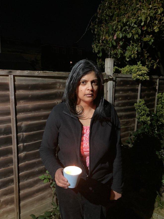 Rupa Huq holding a candle