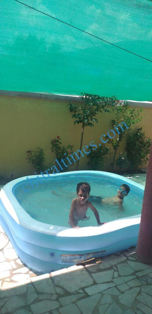 chitraltimes chitral garmi nala child swiming2
