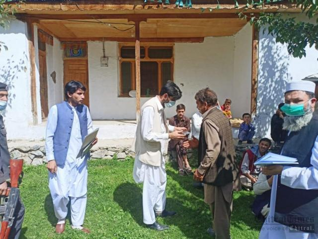 chitraltimes dc upper chitral visit brep distribute cheque among flood effectees1