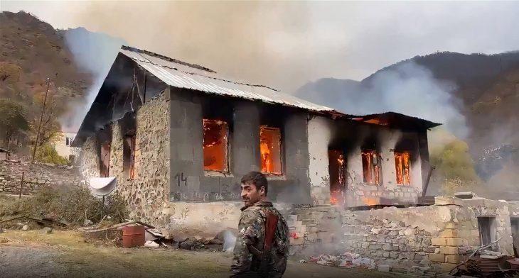Armenia: fleeing residents set their houses on fire
