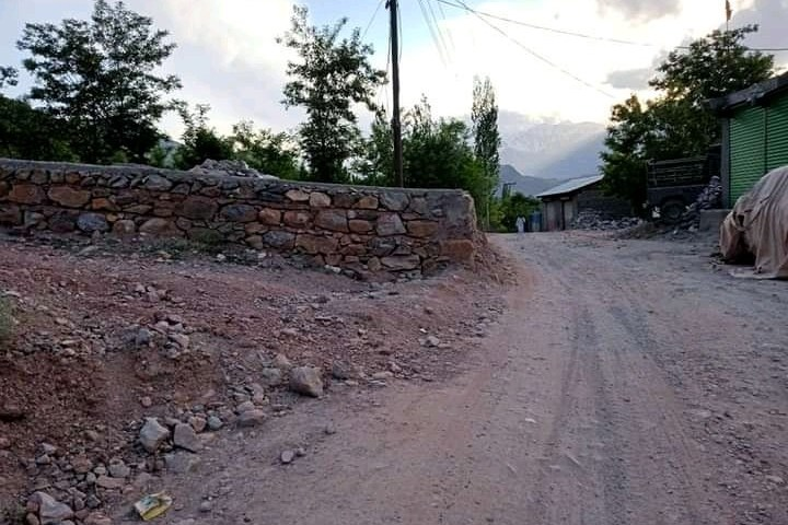 Encroachment slowly eating up road in Awi