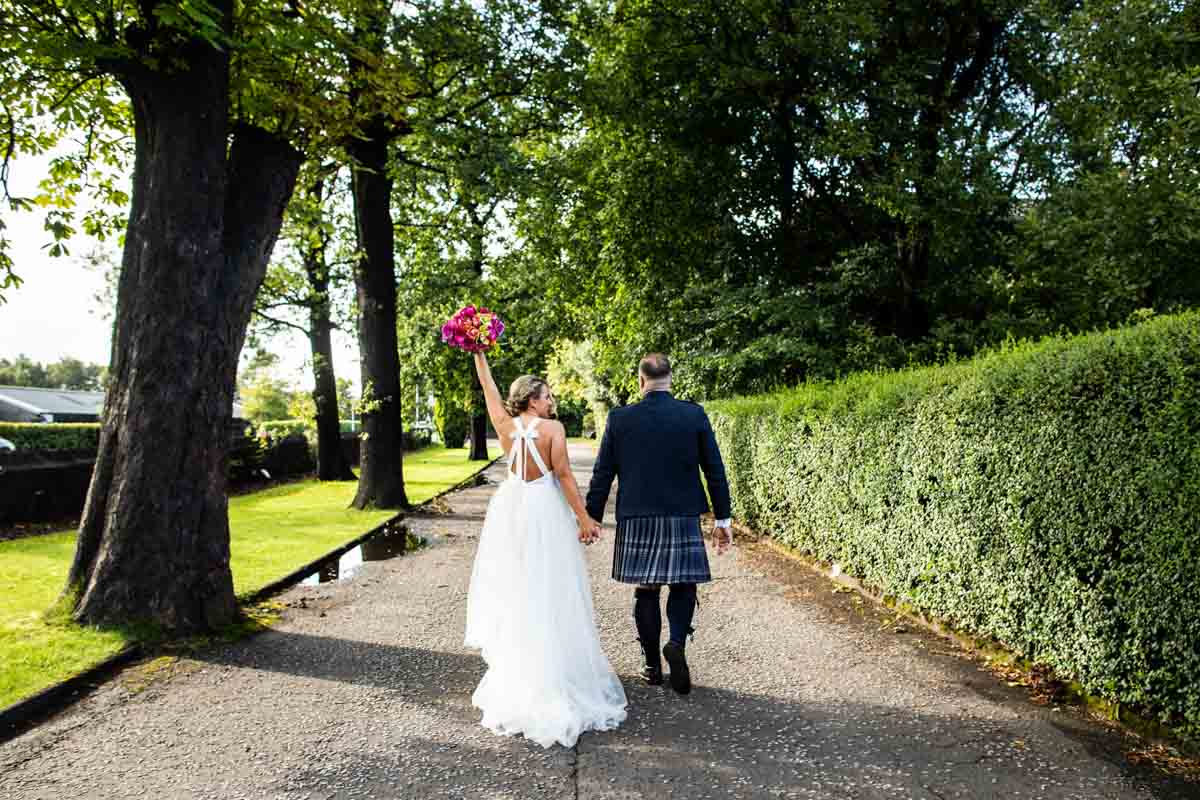 Bride and Groom on the driveway of The Dumbuck Hotel