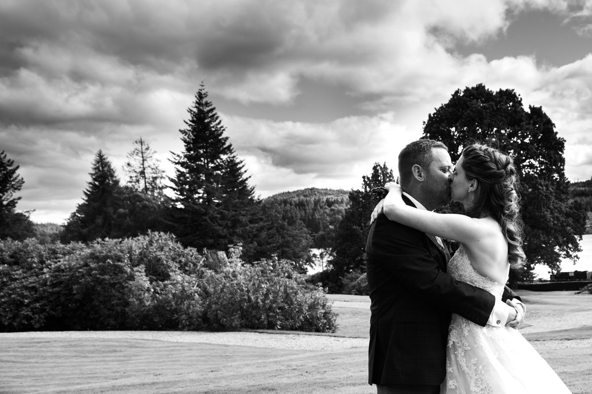 Bride and groom kissing at MacDonald Forest Hills Hotel