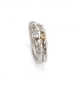 set of sterling silver granulation rings with 9ct gold detail and diamonds