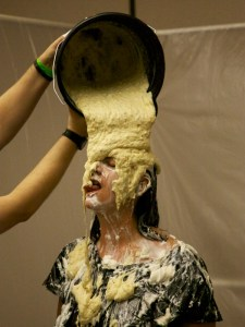 Mistress Messiér gets a taste of yellow cake batter flowing over her head at the Debauchery 2012 messyplay demo.