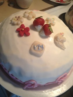 Strawberries filled dark chocolate cake. Covered and decorated with sugar paste.