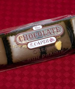 A sleeve containing four milk chocolate dipped toffee pieces.