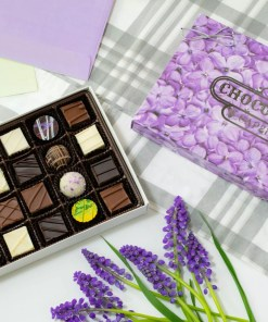 a large seasonal assortment with a lilac-covered box lid laid out with flowers around them