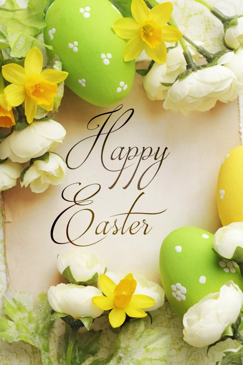 """An elegant green and yellow themed back drop of eggs and flowers with """"Happy Easter"""" written in the center."""