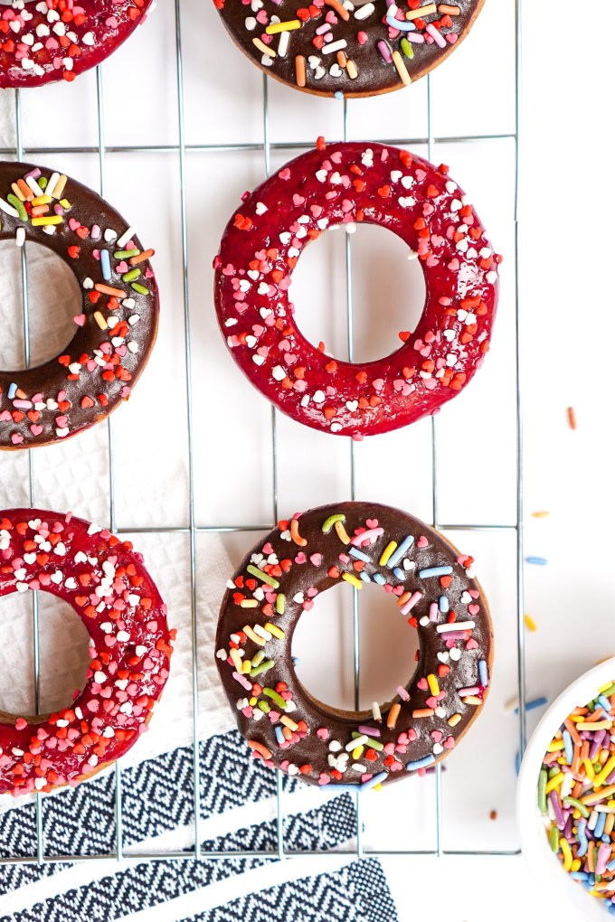 manuka honey donuts decorated with sprinkles and chocolate.