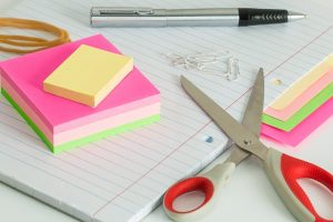 Scissors and sticky notes - some of the packing supplies you must have