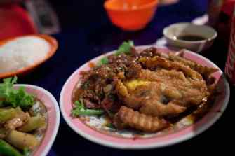 Spring rolls and beef lok lak in Siem Reap, Cambodia.
