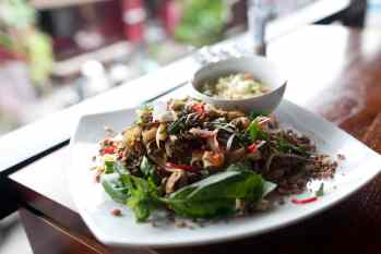 Beef basil ginger with fried noodles and achards in Ubud, Bali.
